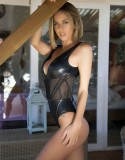 JENNIFER ANN SHOOTING IN PVC BODYSUIT